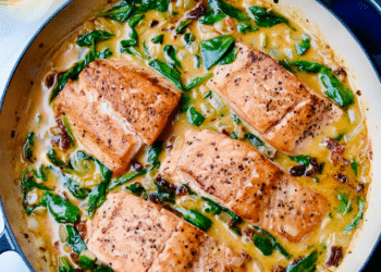 Cast Iron Tuscan Salmon with Creamy Garlic, Spinach & Sun-dried Tomato Sauce